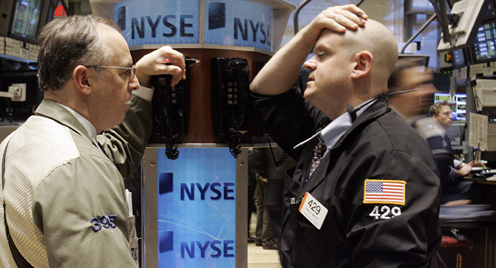 A pair of traders confer at a phone post on the floor of the New York Stock Exchange, Thursday, Jan. 3, 2008