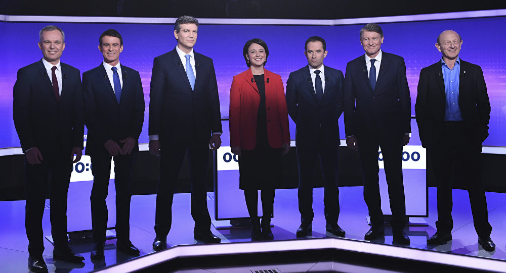 Candidates for the French left's presidential primaries ahead of the 2017 presidential election, (from L) Francois de Rugy, Manuel Valls, Arnaud Montebourg, Sylvia Pinel, Benoit Hamon, Vincent Peillon, Jean-Luc Bennahmias pose before taking part in a final televised debate in Paris, France, Thursday, Jan. 19, 2017
