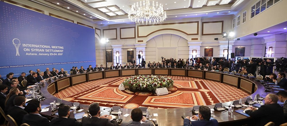 Delegations of Russia, Iran and Turkey hold talks on Syrian peace at a hotel in Astana, Kazakhstan, Monday, Jan. 23, 2017.