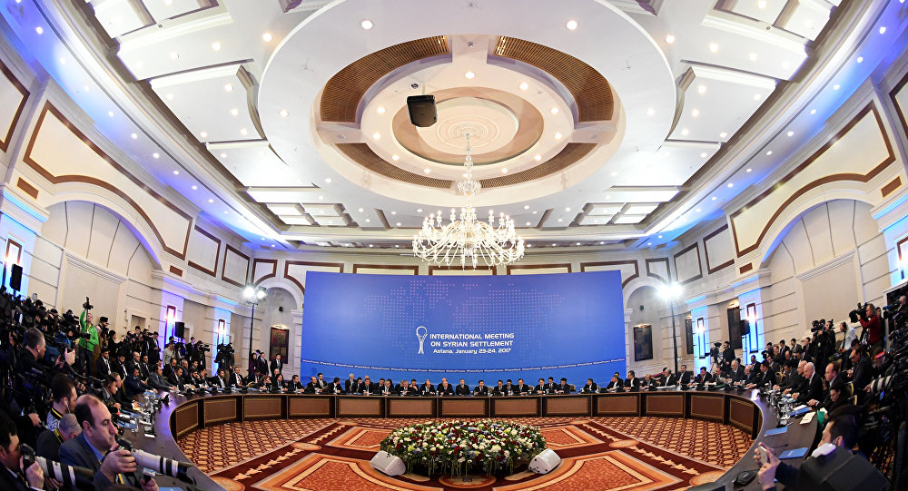 Representatives of the Syria regime and rebel groups along with other attendees take part in the first session of Syria peace talks at Astana's Rixos President Hotel