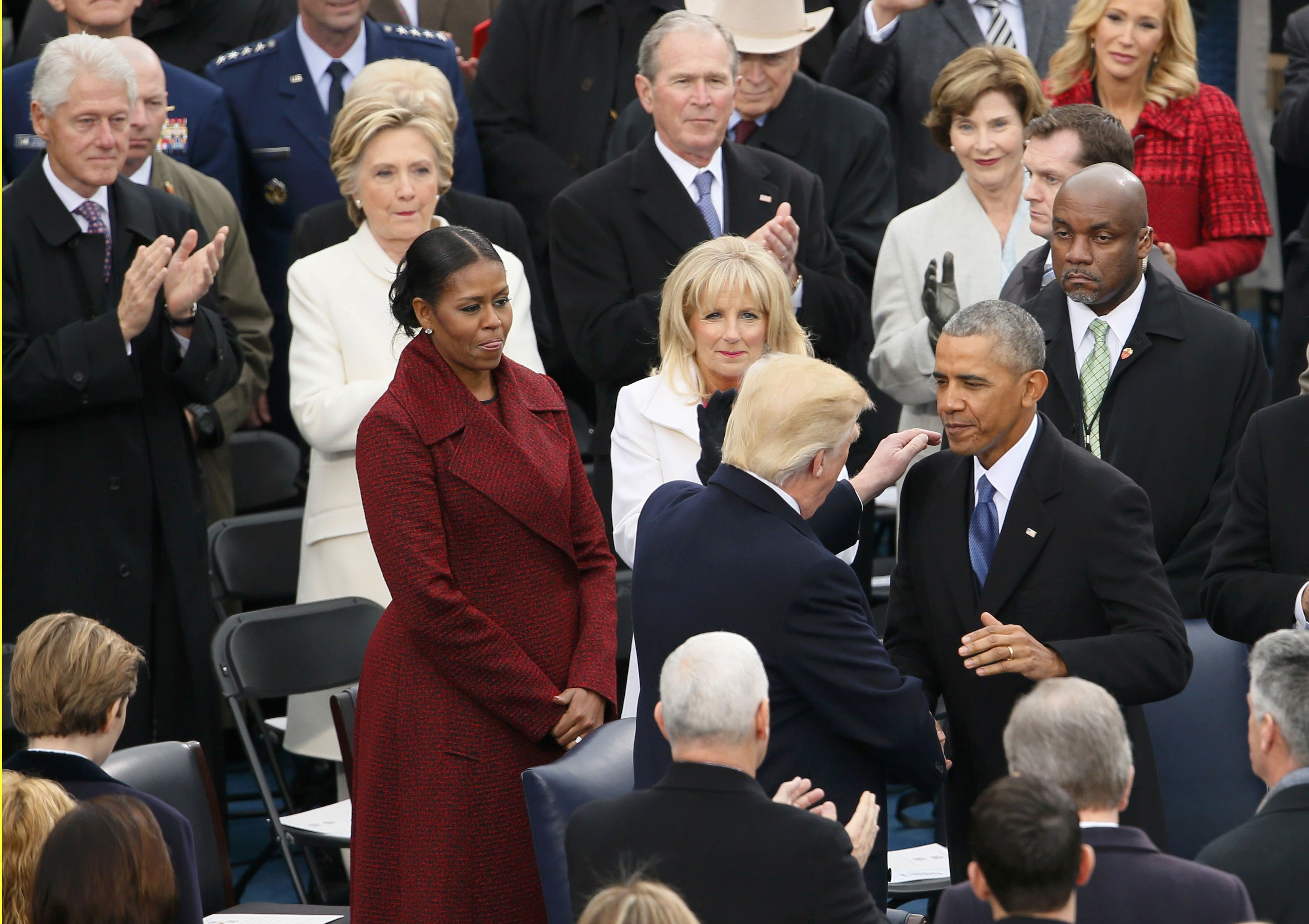 President Obama greets President-elect Donald Trump as former president Bill Clinton, his wife Hillary, and former President George W Bush and his wife Laura look on at the inauguration ceremonies swearing in Donald Trump as the 45th president of the United States on the West front of the U.S. Capitol in Washington, U.S., January 20, 2017