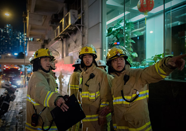 Firemen are seen near the site where a World War II-era bomb weighing almost a tonne was discovered in Hong Kong  (file)