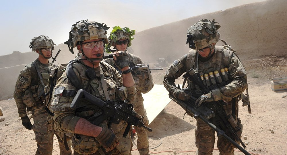 In this photo taken on August 5, 2011, US troops from the Charlie Company, 2-87 Infantry, 3d Brigade Combat Team under Afghanistan's International Security Assistance Force patrols Kandalay village following Taliban attacks on a joint US and Afghan National Army checkpoint protecting the western area of Kandalay village.