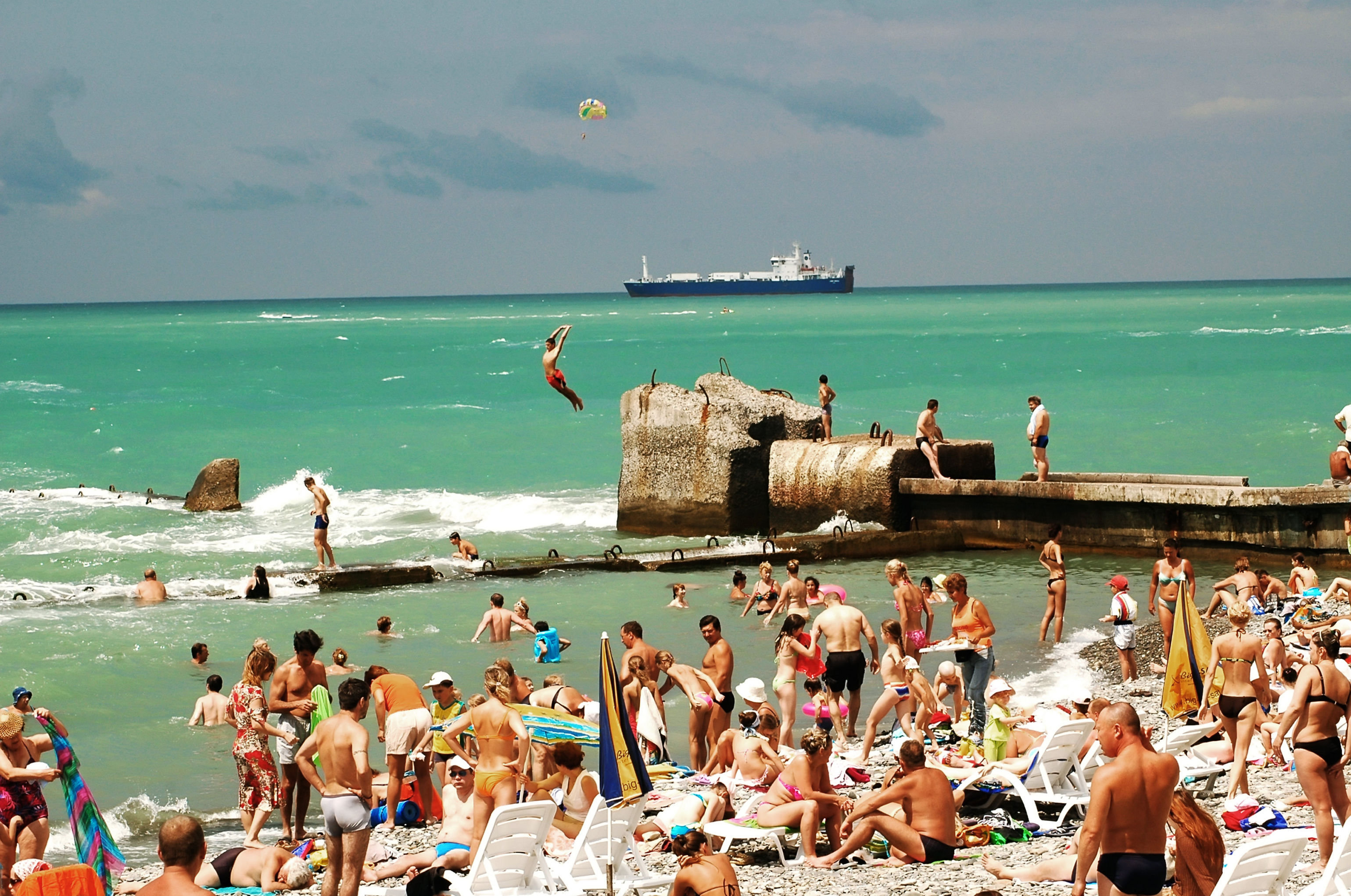 Holiday-makers on the beach in Sochi.