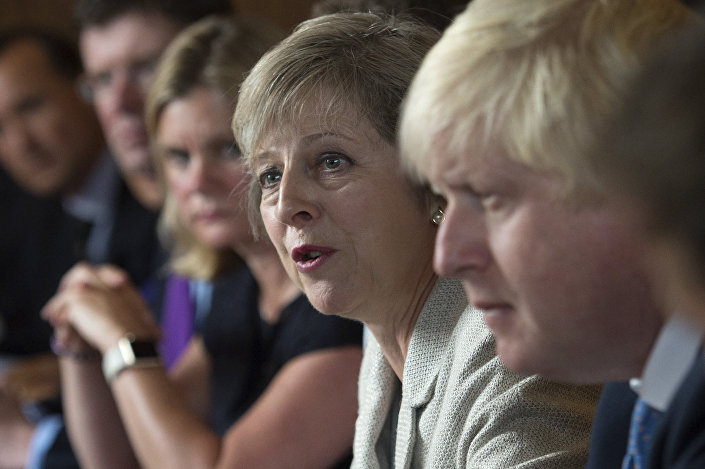 Britain's Prime Minister Theresa May (2R) speaks as she chairs a cabinet meeting sat next to British Foreign Secretary Boris Johnson (R) at the Prime Minister's country retreat Chequers near the village of Ellesborough in Buckinghamshire, northwest of London, on August 30, 2016.