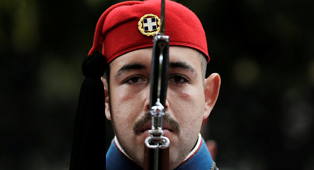 A Greek Presidential Guard presents arms before the arrival of Italian President Sergio Mattarella at the Presidential Palace in Athens, Greece, January 17, 2017.