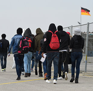 Migrants arrive at the first registration point for asylum seekers in Erding near Munich, southern Germany, on November 15, 2016