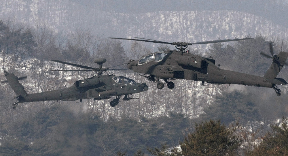 U.S. Apache helicopters take to the air during an aerial gunnery exercise at a military firing range in Pocheon, South Korea (File)