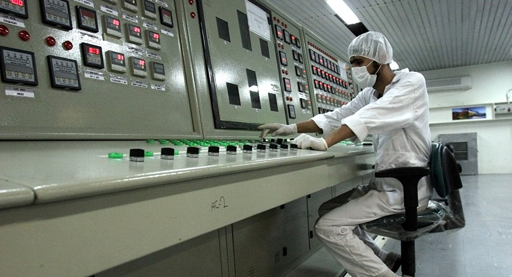 In this file photo, an Iranian technician works at the Uranium Conversion Facility just outside the city of Isfahan 255 miles (410 kilometers) south of the capital Tehran, Iran