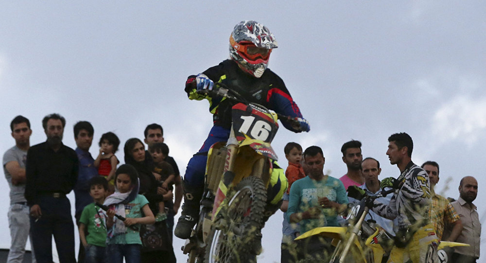 Female motocross at a racetrack near the village of Baraghan, some 19 miles (30 kilometers) west of the capital Tehran, Iran