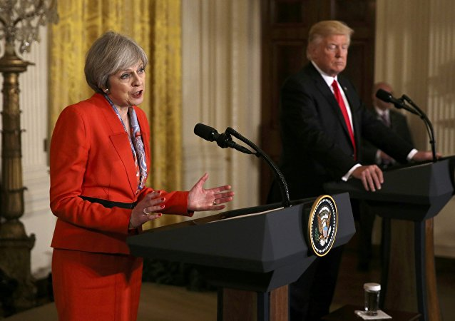 British Prime Minister Theresa May speaks as US President Donald Trump listens during their joint news conference at the White House in Washington, US, January 27, 2017