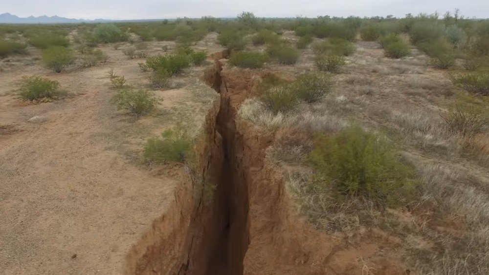 A 1.8 mile long fissure discovered in the Arizona desert. The fissure runs as much as 10 feet wide and 30 feet deep.