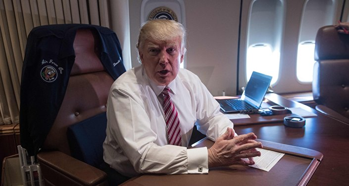 US President Donald Trump poses in his office aboard Air Force One at Andrews Air Force Base in Maryland after he returned from Philadelphia on January 26, 2017