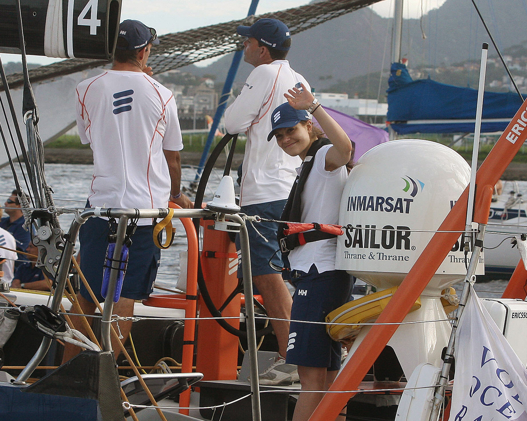Princess Victoria (C) of Sweden waves to the press on board the Ericsson 4, before the start of the In-Port Race in Guanabara Bay in Rio de Janeiro on April 04, 2009 within the Volvo Ocean Race 2008/2009