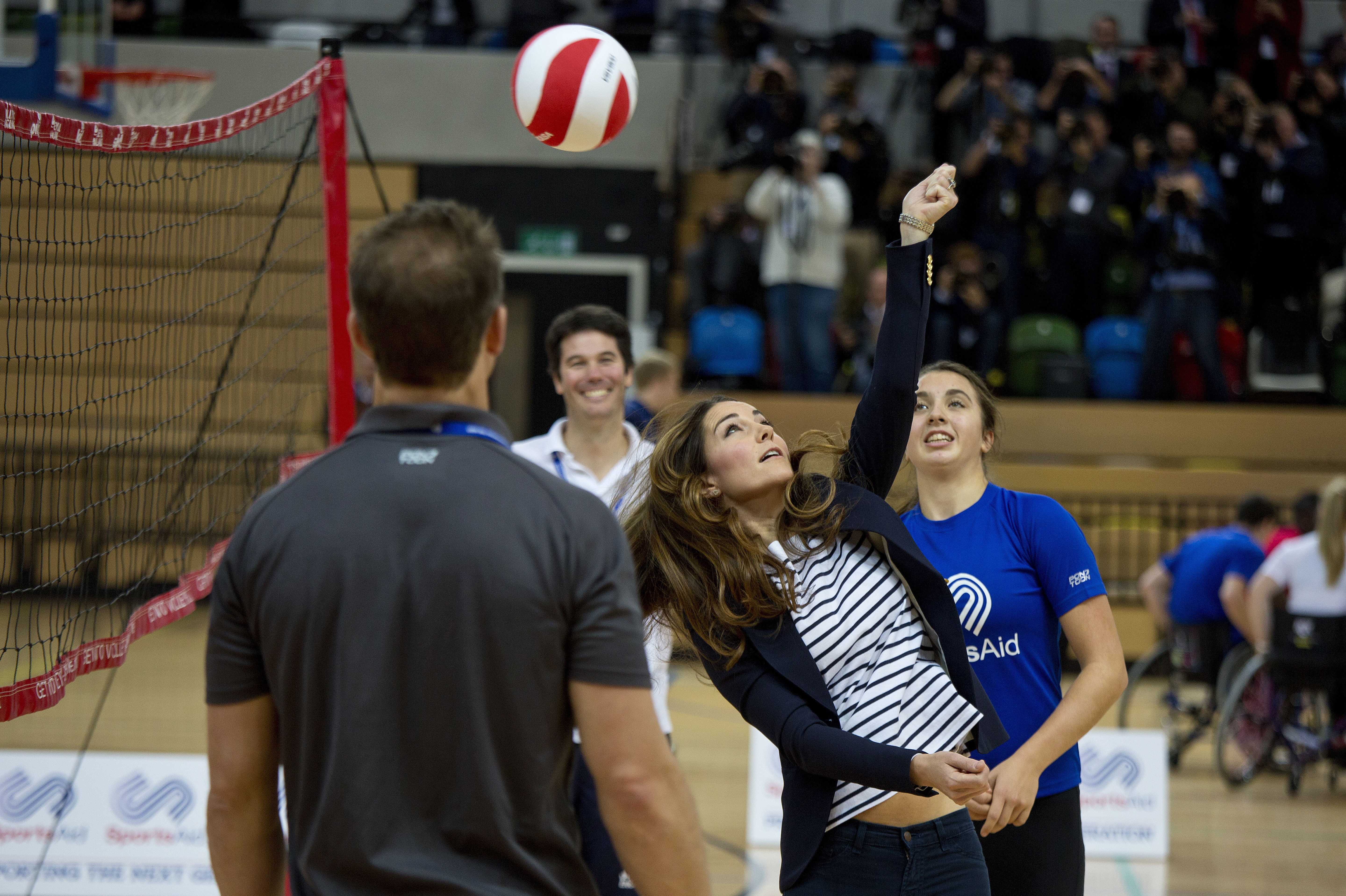 Britain's Catherine, Duchess of Cambridge (2nd R), plays volleyball during a trip to the SportsAid Athlete Workshop in the Copper Box at the Queen Elizabeth Olympic Park in east London on October 18, 2013