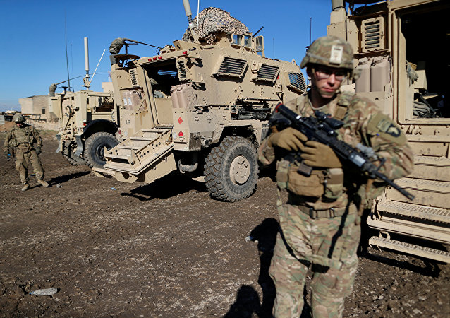 US army soldiers stand next a military vehicle in the town of Bartella, east of Mosul, Iraq. File photo