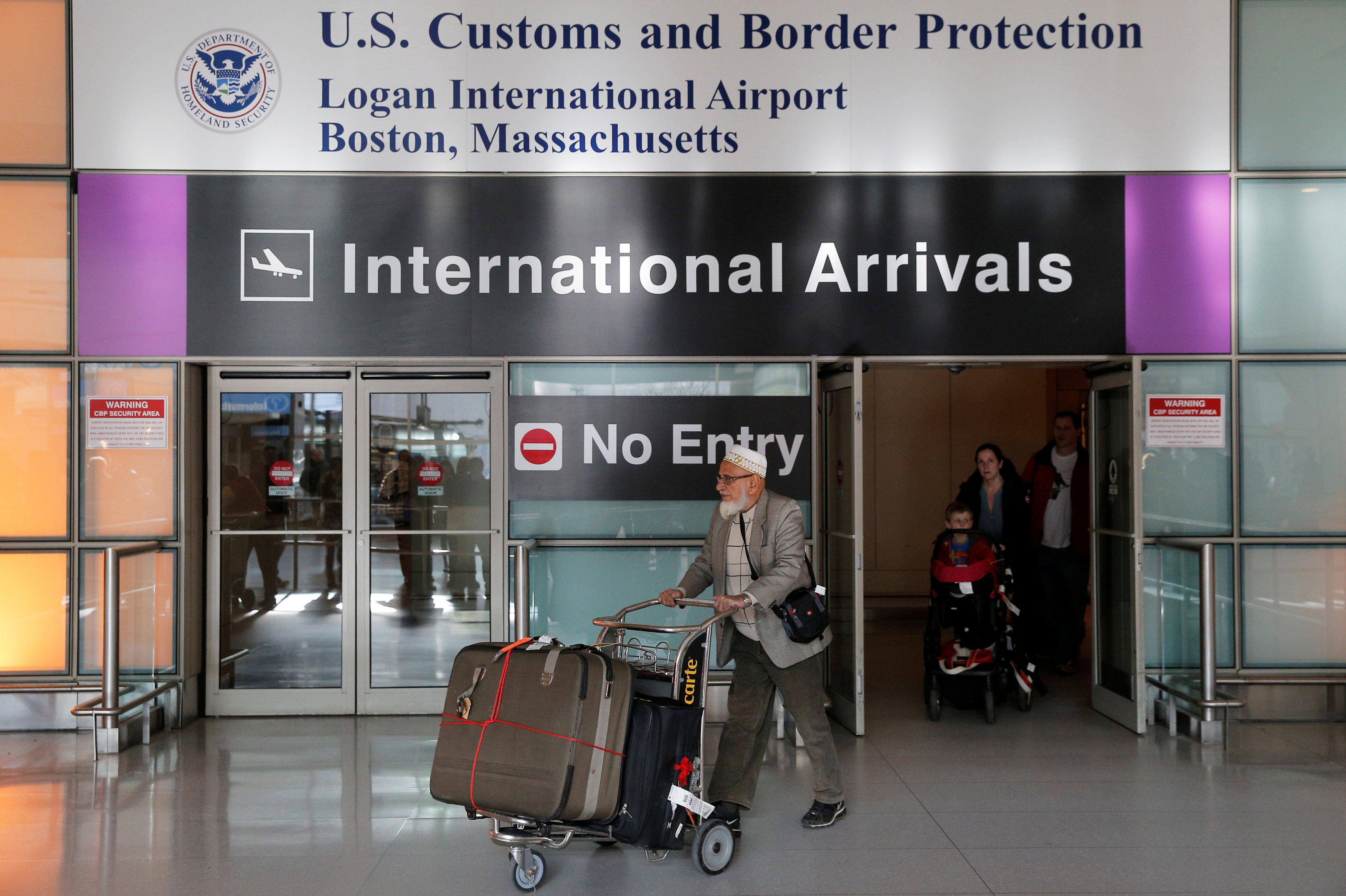 International travelers arrive after U.S. President Donald Trump's executive order travel ban at Logan Airport in Boston, Massachusetts, U.S