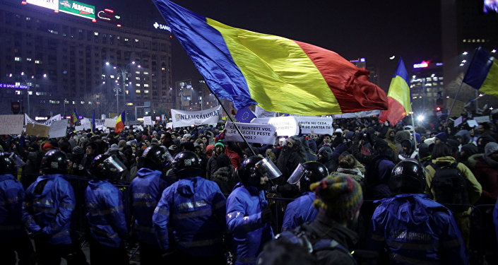 Protesters wave a Romanian flag during a demonstration in Bucharest, Romania, February 1, 2017.