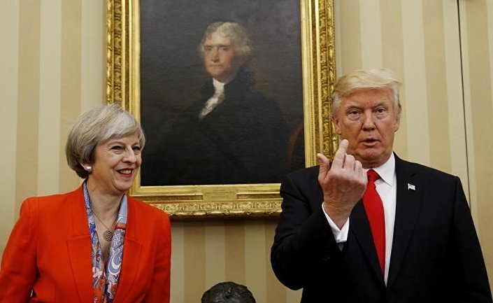 US President Donald Trump gestures as he meets with British Prime Minister Theresa May in the Oval Office of the White House in Washington January 27, 2017.