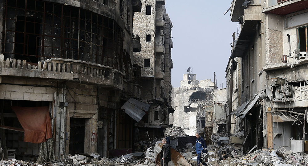 Syrians walk through the destruction in the old city of Aleppo, Syria