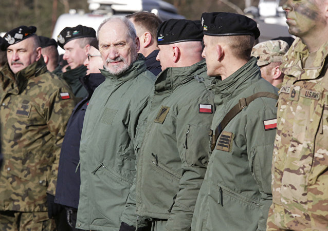 Polish Defense Minister Antoni Macierewicz, fourth right, stands with soldiers during the opening of joint Polish and U.S. exercise on training fields in Zagan, Poland, Monday, Jan. 30, 2017