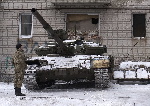 Ukrainian serviceman stands near tanks at an apartment house in Avdiivka, eastern Ukraine, Thursday, Feb. 2, 2017
