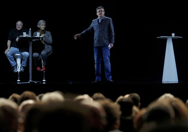 The hologram of politician Jean-Luc Melenchon (R), of the French far-left Parti de Gauche, and candidate for the 2017 French presidential election, speaks to supporters who are gathered in Saint-Denis, near Paris France, February 5, 2017 as Melenchon campaigns in Lyon