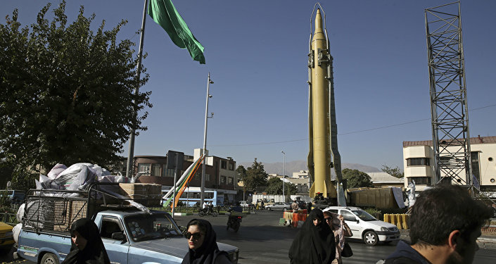 Iranians walk past a Ghadr-F missile displayed at a Revolutionary Guard hardware exhibition, marking 36th anniversary of the outset of Iran-Iraq war, at Baharestan Sq. in downtown Tehran, Iran (File)