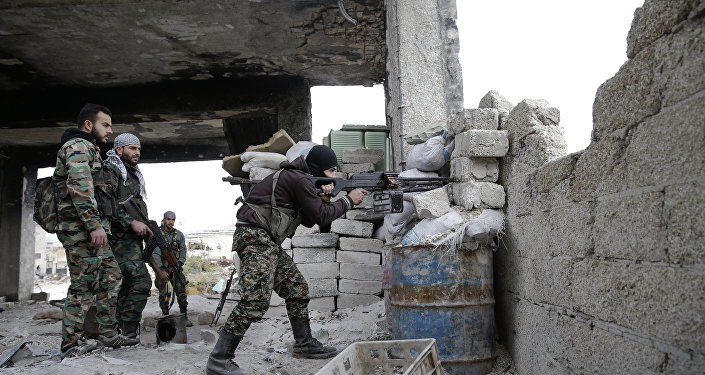 In this Monday, Dec. 5, 2016 photo, Syrian army soldiers fire their weapons during a battle with insurgents at the Ramouseh front line, east of Aleppo, Syria