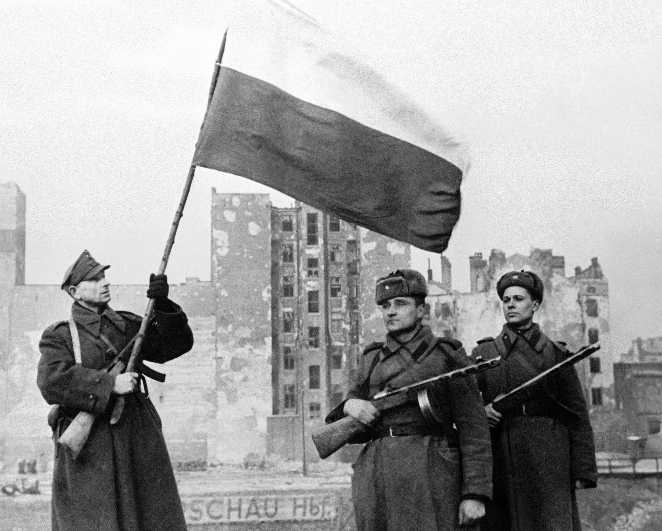 Soldiers of Wojsko Polske (left with flag) and Soviet Army (right) raising a flag in liberated Warsaw