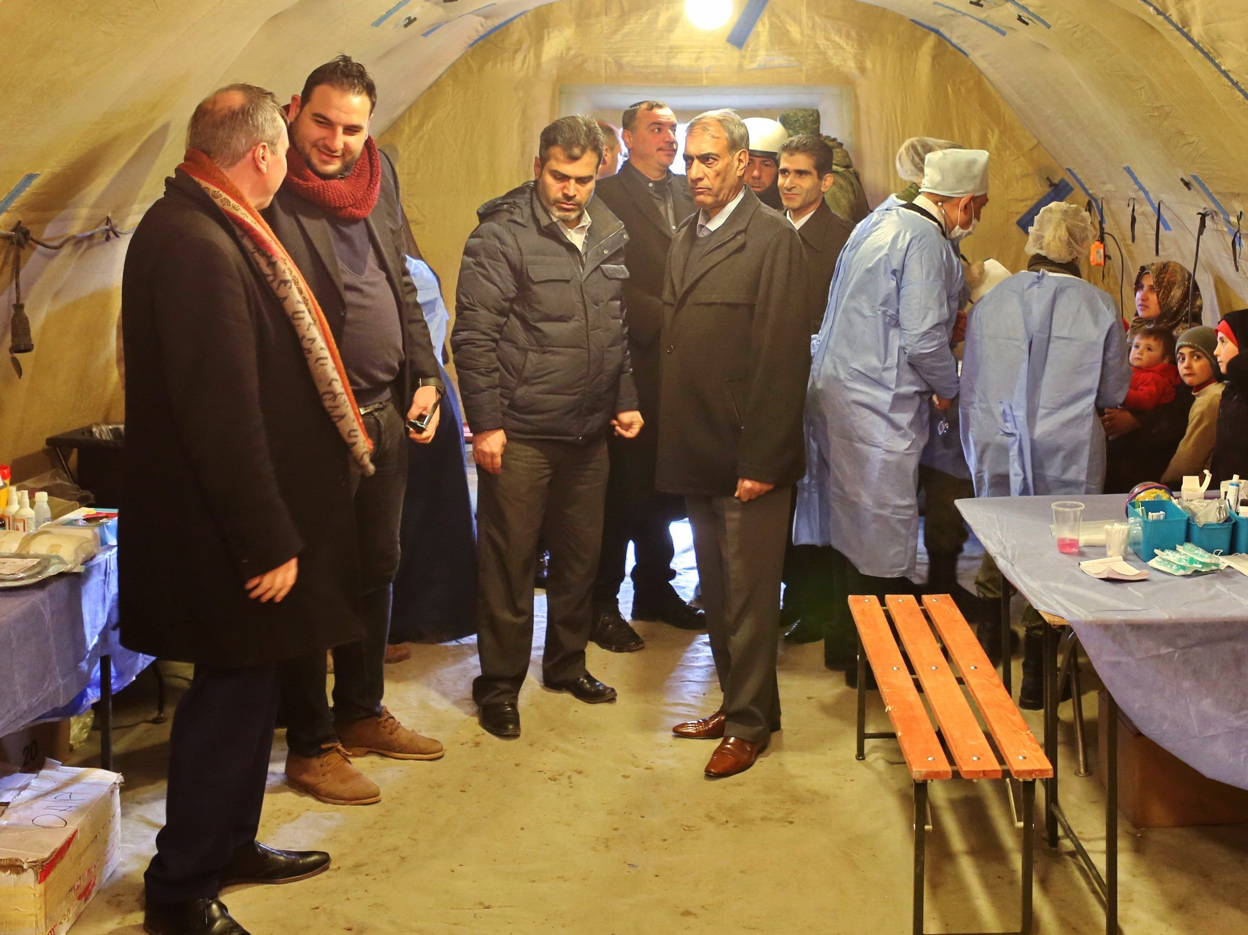 A delegation of Belgian MPs visit the temporary refugee shelter in Jibreen, Aleppo. Photo: Courtesy of The Russian Center for Reconciliation of Opposing Sides in the Syrian Arab Republic