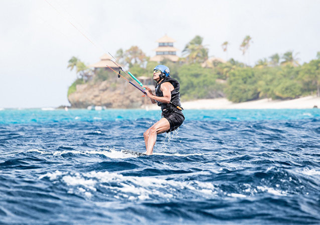 Former U.S. President Barack Obama tries his hand at kite surfing during a holiday with British businessman Richard Branson on his island Moskito, in the British Virgin Islands