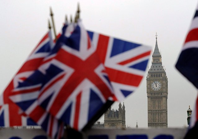 Union flags displayed on a tourist stall, backdropped by the Houses of Parliament and Elizabeth Tower containing the bell know as Big Ben, in London, Wednesday, February 8, 2017.