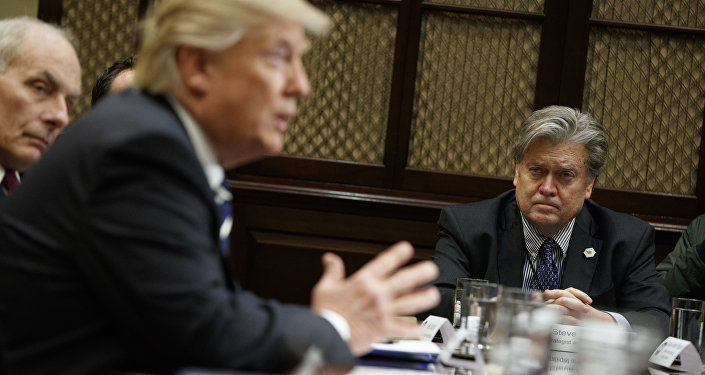 White House Chief Strategist Steve Bannon listens at right as President Donald Trump speaks during a meeting on cyber security in the Roosevelt Room of the White House in Washington, Tuesday, Jan. 31, 2017.