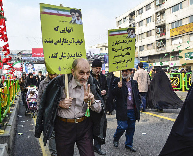 Iranians marching during rally in Tehran