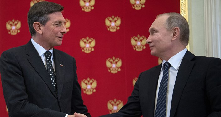 Russian President Vladimir Putin and Slovenia's President Borut Pahor, left, during a joint press conference following their meeting