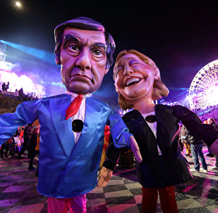 Figures of Francois Fillon (L), former French prime minister, member of The Republicans political party and 2017 presidential candidate of the French centre-right, and French National Front leader Marine Le Pen are paraded through the crowd during the 133rd Carnival parade, the first major event since the city was attacked during Bastille Day celebrations last year in Nice, France, February 11, 2017