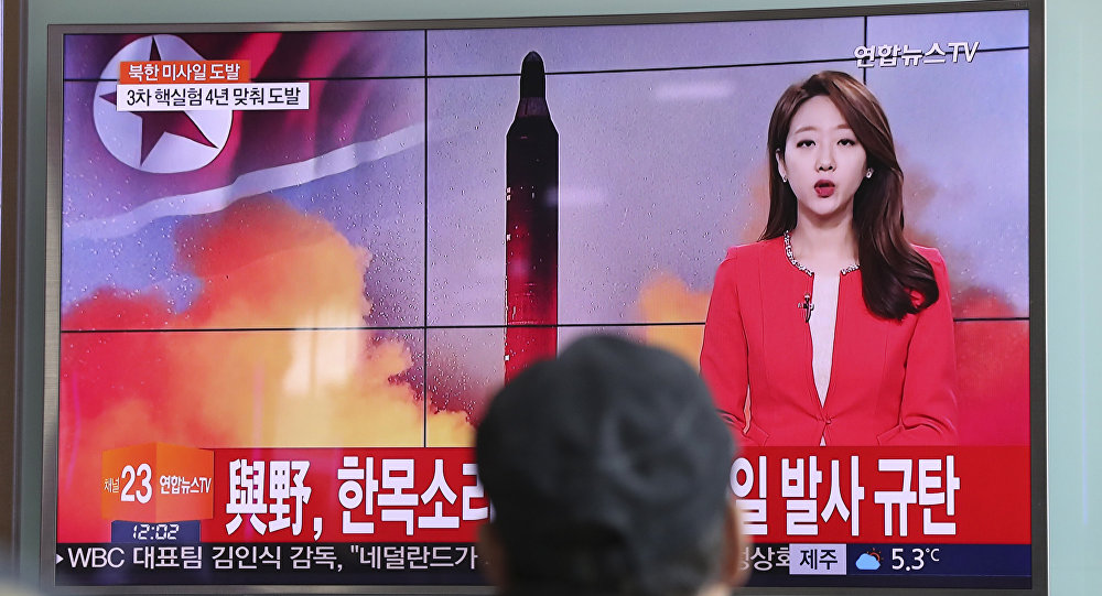 A man watches a TV news program reporting about North Korea's missile launch (File Photo)