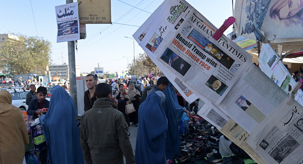 Newspapers display an image of victorious Republican candidate Donald Trump and coverage of the US presidential elections, in Kabul on November 10, 2016