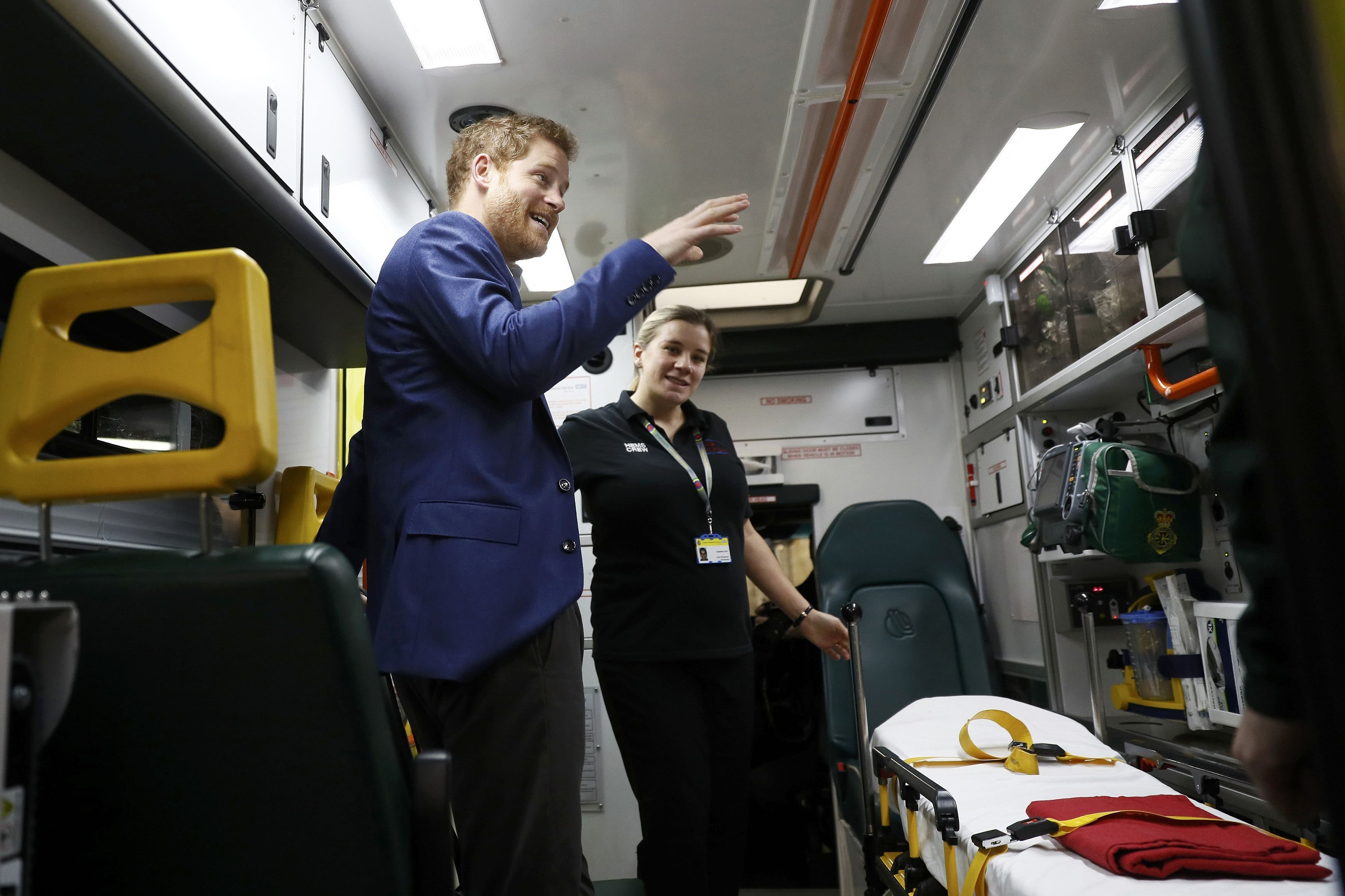 Prince Harry talks to medical staff in an ambulance as part of the Heads Together campaign at the London Ambulance Service in central London, Britain February 2, 2017