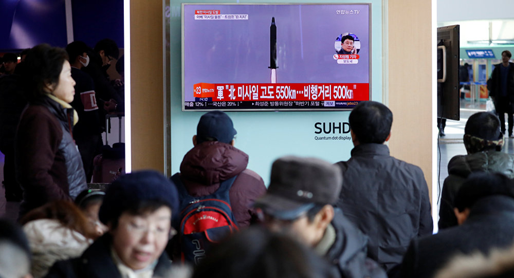 Passengers watch a TV screen broadcasting a news report on North Korea firing a ballistic missile into the sea off its east coast, at a railway station in Seoul, South Korea, February 12, 2017