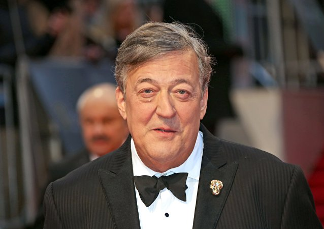 Stephen Fry poses for photographers upon arrival at the British Academy Film Awards in London, Sunday, Feb. 12, 2017