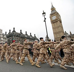 Soldiers from the British 7th Armoured Brigade who have returned from service on operations in Iraq march past Big Ben in London (File)