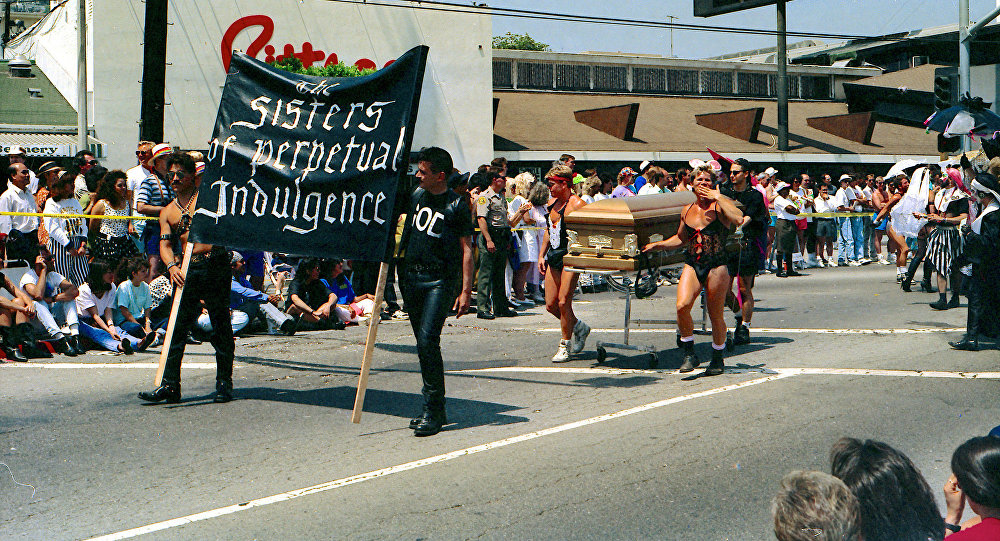 The Sisters of Perpetual Indulgence. Gothic drag. And they appear to be in the parade for a reason - to fulfill a dying wish - this is a real funeral procession - in 1991 - AIDS had people dropping left and right