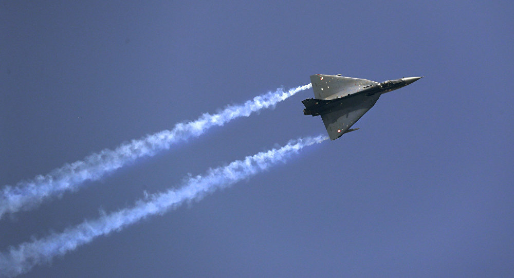 Indian Air Force indigenous Tejas Light Combat Aircraft displays its manoeuvrability during Air Force day parade at the Hindon air base on the outskirts of New Delhi, 8 October 2016