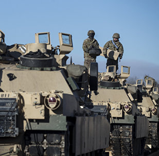 Members of US Army's 4th Infantry Division 3rd Brigade Combat Team 68th Armor Regiment 1st Battalion prepare to unload some Abrams battle tanks after arriving at the Gaiziunai railway station, some 110 kms (69 miles) west of the capital Vilnius, Lithuania, Friday, Feb. 10, 2017.