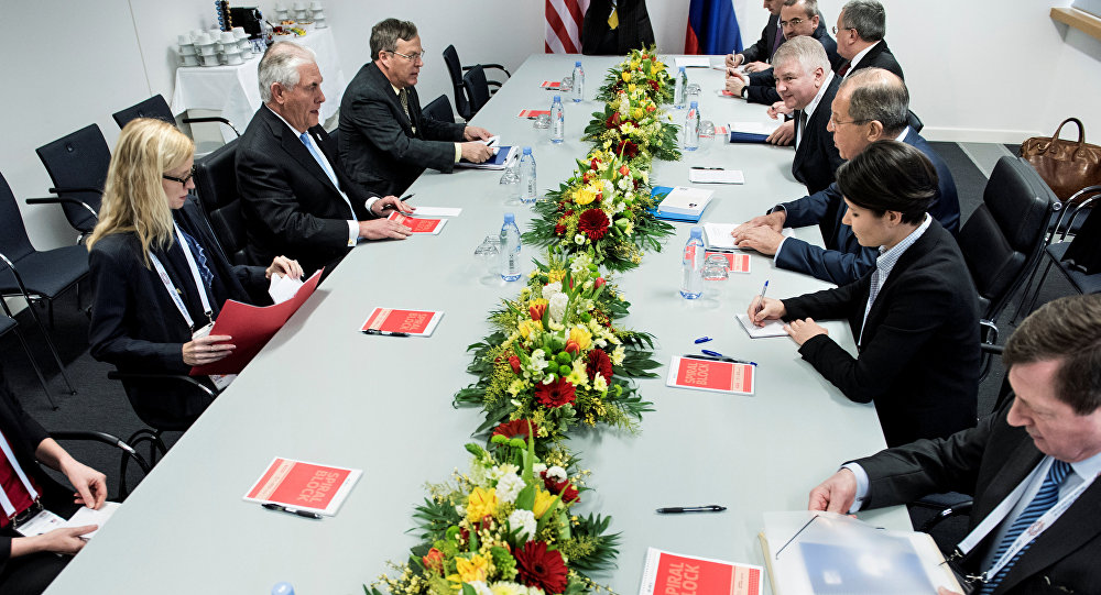 US Secretary of State Rex Tillerson (2ndL), Russia's Foreign Minister Sergei Lavrov (3rdR) and others wait for the start of a meeting at the World Conference Center in Bonn, Germany February 16, 2017.