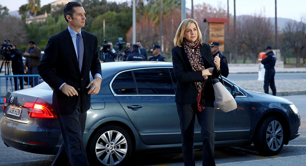 Spain's Princess Cristina (R) arrives at the court with her husband Inaki Urdangarin, to appear on charges of tax fraud, as a long-running investigation into the business affairs of her husband goes to trial in Palma de Mallorca, Spain, January 11, 2016.