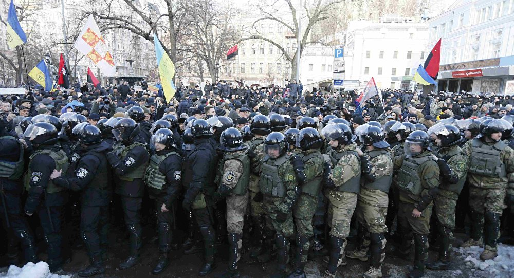 Riot police and members of the Ukrainian National Guard block activists and supporters of nationalist parties during a rally against trade with Ukraine's rebel-held east areas in Donetsk and Luhansk regions, in Kiev, Ukraine