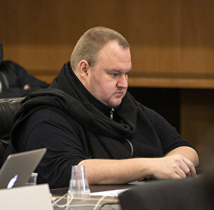 German tech entrepreneur Kim Dotcom sits in a chair during a court hearing in Auckland, New Zealand, September 24, 2015